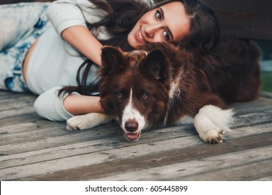 Woman and her favorite dog portrait. Focus on the dog