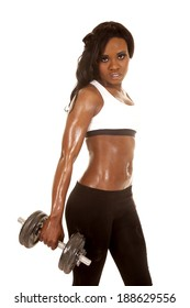 A woman in her fitness clothing holding on to a weight