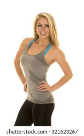 A woman in her fitness clothing showing her fit body.