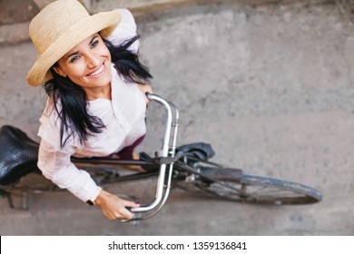 Woman in her forties riding bicycle