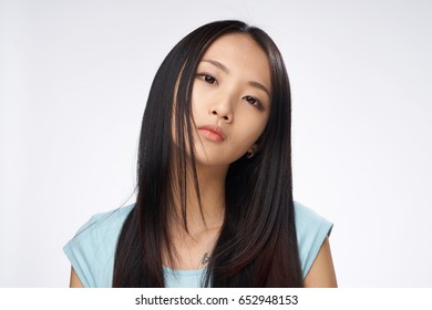 Woman with her hair on a light background