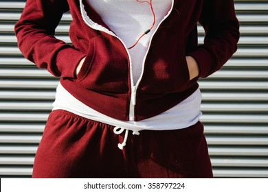 Woman with her hands tucked in the pockets of her sweatshirt