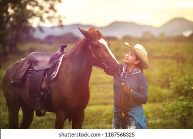 woman with her horse in evening sunset light. Outdoor photography with fashion model girl. Lifestyle mood