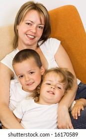 Woman with her kids on the sofa