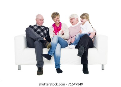 Woman with her parents and daughter in a sofa isolated on white background