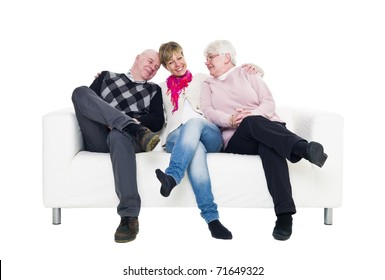 Woman with her parents in a sofa isolated on white background