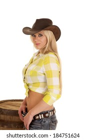 A woman in her plaid top and cowgirl hat.