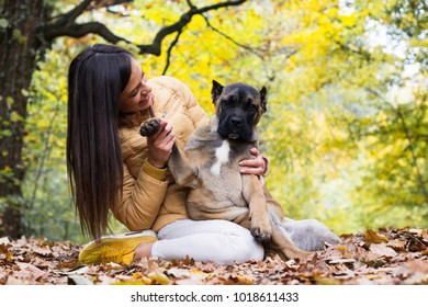 Woman and her puppy together