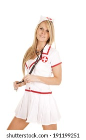 A woman in her vintage nurse uniform with a stethoscope around her neck.