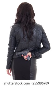 woman hiding gun behind her back isolated on white background
