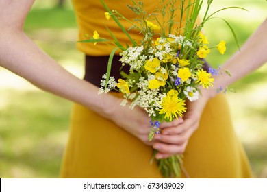 Image result for woman with flowers behind her back