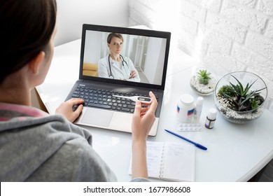 A woman with a high fever got the flu, an online consultation with her physician therapist. Medical technology, video chat with a doctor