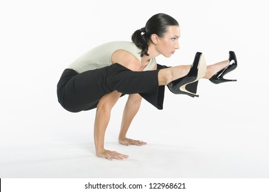 Woman with high heels exercising