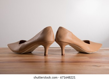 woman high heels shoes on wood and white background