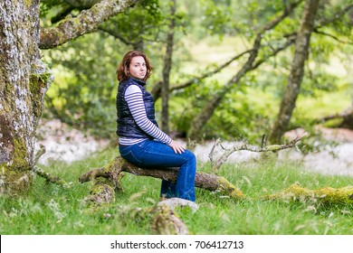 Woman in Highlands mountains in Scotland, UK