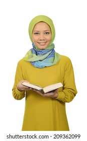 Woman in hijab reading Koran isolated over white background