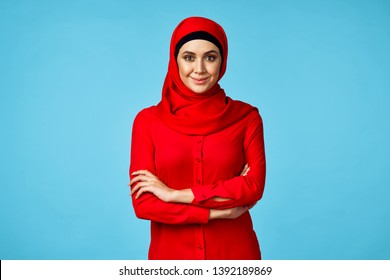 woman in hijab and red dress