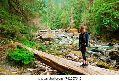A Woman Hiker Along the Skokomish River In Olympic National Park, Washington