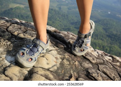 woman hiker climbing at mountain peak