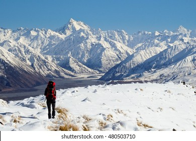 A Woman Hiker Climbs a Snowy Mountain on a Sunny Day  Hakatere Conservation Park, Southern Alps, New Zealand