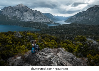 Woman hiker enjoying the valley view from viewpoint. City of Bariloche, Argentina