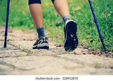 woman hiker hiking in green grass