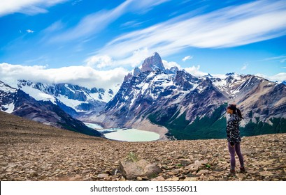 Woman hiker looking out at Mount Fitz Roy in El Chalten Argentina