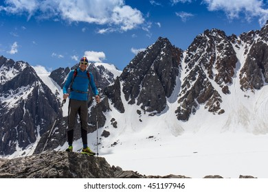 Woman hiker on a top of  mountain