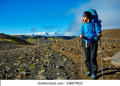 woman hiker on the trail in the Islandic mountains. woman standing and posing against the backdrop of a desert mountain landscape. Treking in National Park Landmannalaugar, Iceland. Travel photography