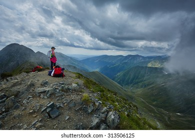 Woman hiker on a trail in the mountains in a beautiful scenery