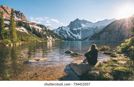 Woman hiker standing in front of Snowmass Mountain at sunset Colorado