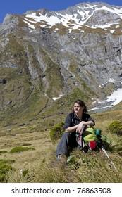 Woman hiker taking a break in the Wilkin River Valley, New Zealand