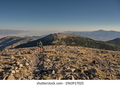 Woman Hikes Through Rocky Field on the way up to Wheeler Peak in Great Basin National Park