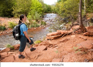 Woman Hiking Along River (Sedona, Arizona)