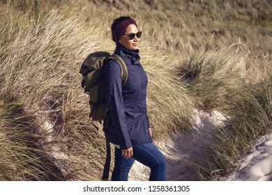 Woman hiking in the dunes of Amrum Germany.