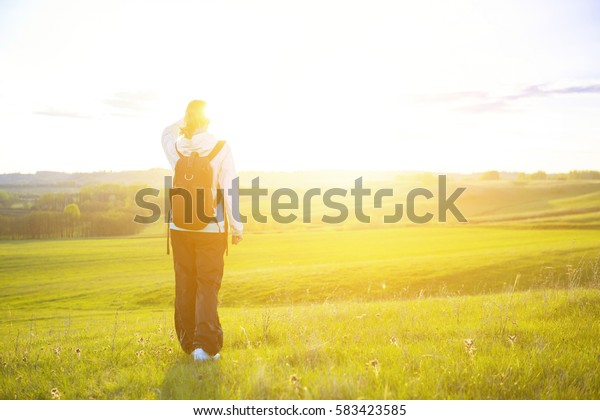 Woman hiking. Fresh and healthy female model during hike outdoors in field.