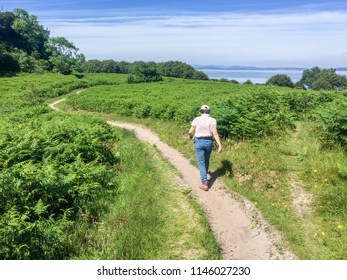 Woman hiking in nature on the Isle of Arran of Scotland, taken in 2017