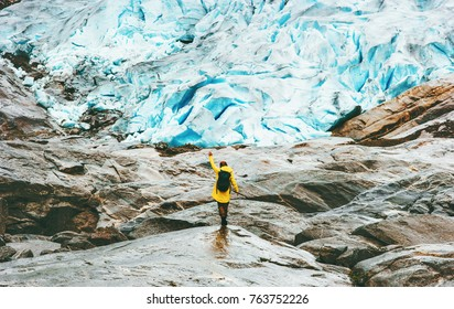 Woman hiking at Nigardsbreen glacier  Travel Lifestyle ecology concept adventure vacations outdoor nature in Norway
