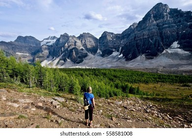 Woman hiking in rocky mountains. Valley of Ten Peaks. Banff National Park. Canadian Rocky Mountains. British Columbia. Canada.