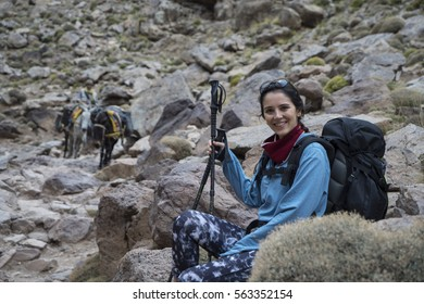 Woman hiking and take a break in the Mount Toubkal