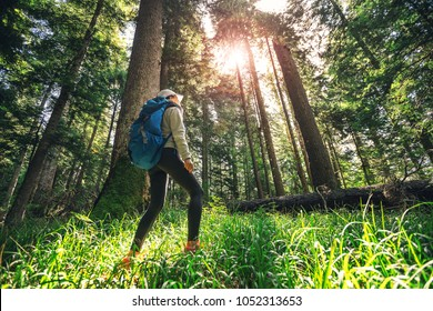 woman hiking through forest