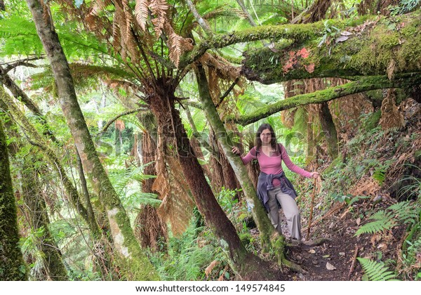 Woman hiking through lush green jungle in Bolivia