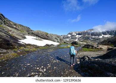 woman hiking in trolltunga mountains