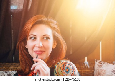 Woman hipster drinking smoothie in hip cool cafe making funny face expression looking to the side. Beautiful young mixed race Caucasian girl model.