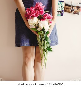 woman hipster holding peony bouquet close-up in the morning, sweet tender romantic moment , space for text