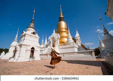 Woman hipster is sightseeing inside Wat Suan Dok in Chiangmai, Thailand.