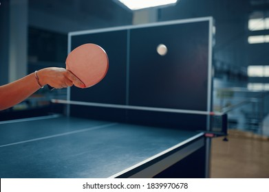 Woman hits ball at the wall, table tennis workout