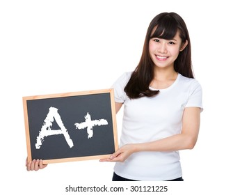 Woman hold with chalkboard showing mark A plus