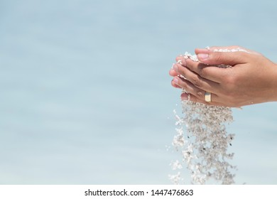 the woman hold Chyle or Argil or clay or sand in the hand at the Salda lake from Turkey.