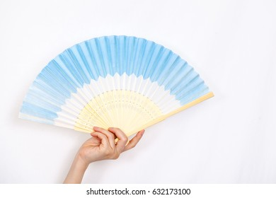 woman hold fan in her hand.